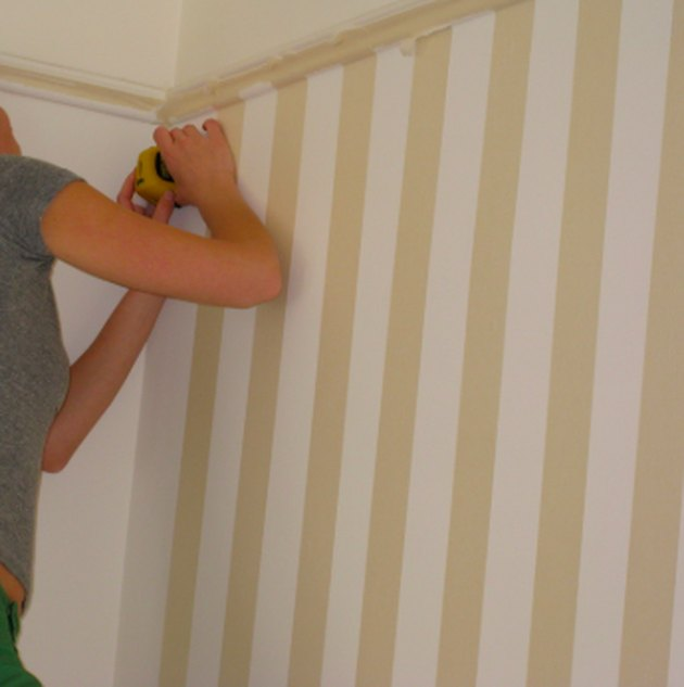 Divide the wall width by an odd number to guarantee matching stripes int he corners. Image Credit: Value Painting